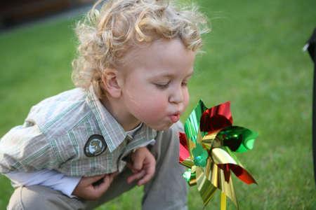 Boy with a pinwheel  photo
