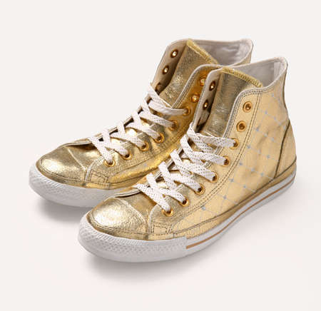 Golden vintage shoes on white background. Stock Photo