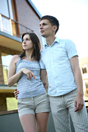 Couple in front of house. photo