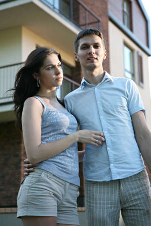 Couple in front of house. Stock Photo - 5429595