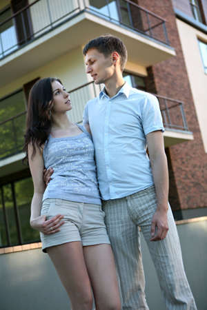 appartment: Couple in front of house. Stock Photo