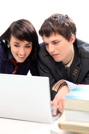 Happy young couple looking at laptop photo