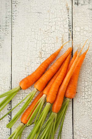 Homegrown carrots on vintage table photo