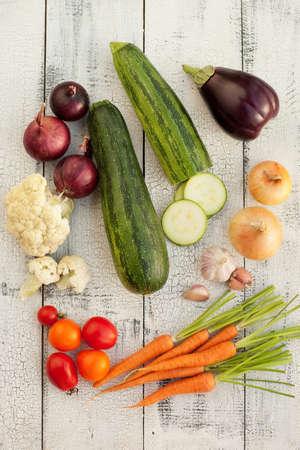 Homegrown vegetables on vintage table   photo