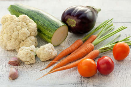 homegrown: Homegrown vegetables on vintage table   Stock Photo