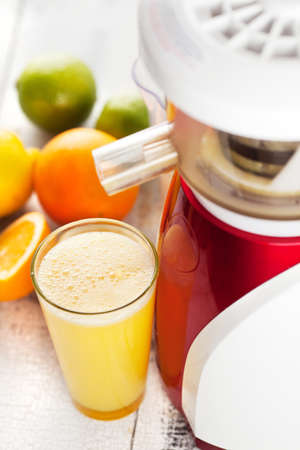 Slow juicer and orange juice    photo