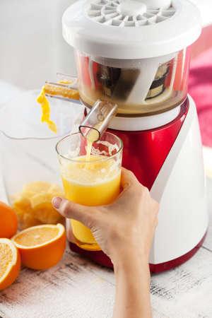 Slow juicer and orange juice