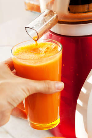 Slow juicer and carrot juice  photo
