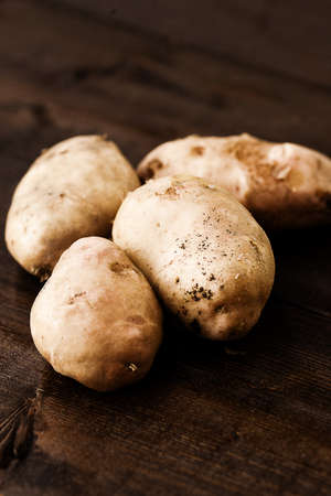 homegrown: Homegrown potatoes on vintage table
