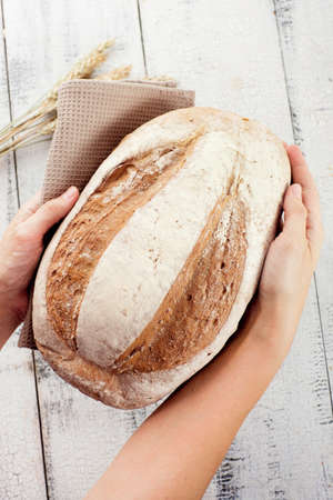bakery products: Fresh bread and wheat in hands  Stock Photo