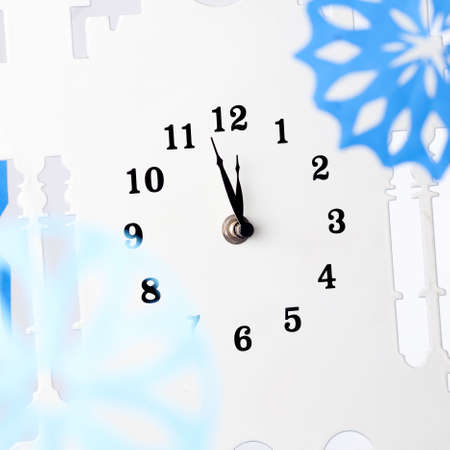 Paper snowflakes and clock. A New Years Eve photo