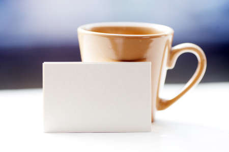 contact sheet: Business card on windowsill against a cup, city view behind. Stock Photo