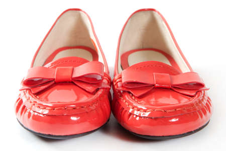 children s feet: Female red shoes on white background Stock Photo