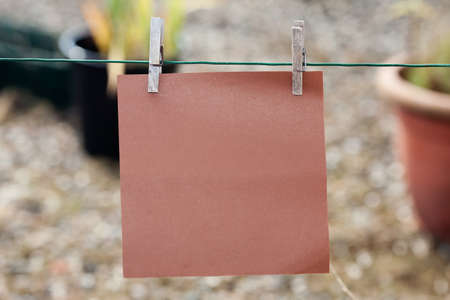 clothes pin: paper card hanging on string