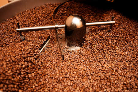 roaster: roasted coffee in roaster Stock Photo