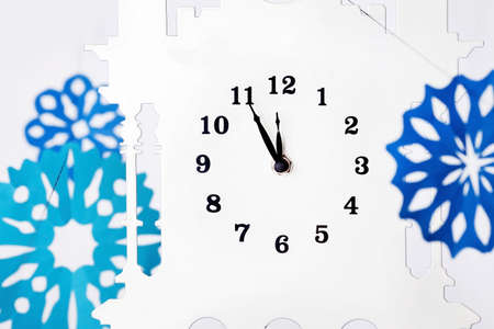 Paper snowflakes and clock photo