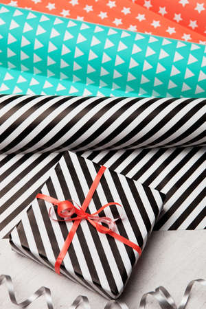 Gifts and wrapping paper. Christmas background. Birthday background