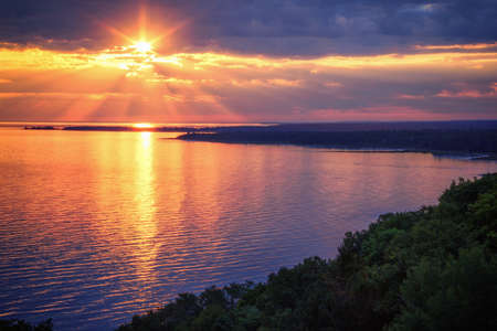 Lake Michigan Coastline Sunset. A scenic view from the Cut River Bridge roadside park overlooking Epoufette Bay in Michigans Upper Peninsula. Lakeshore background with copy space. Stock fotó