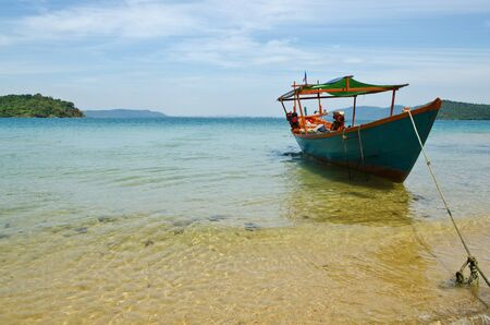The fishing boat at Sihanouk Ville beach photo