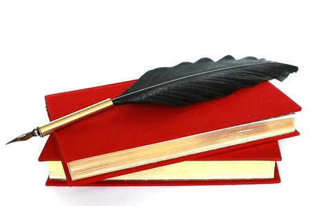 Two red books and quill isolated on white background Stock Photo - 8930898