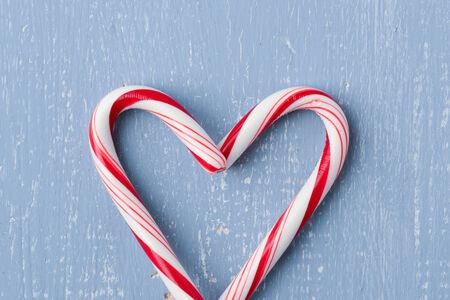 Candy Cane Heart Symbol on Blue Wood photo