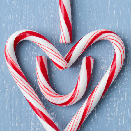 red velvet cupcake: Candy Cane Heart Symbol Spelling \\\I Heart U\\\ on Blue Wood with Snowflake Stock Photo