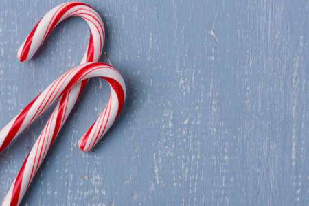 Candy Canes on Light Blue Wood Background photo