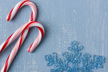 Upclose of Candy Canes on Light Blue Wood Background photo