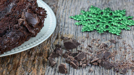 fattening: Chocolate Chunk Cake on Wooden Background