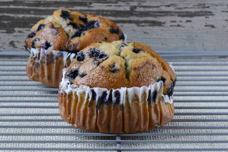 Fresh Blueberry Muffins on Rustic Burlap Background photo