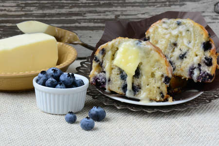 Fresh Blueberry Muffin on Rustic Burlap Background photo