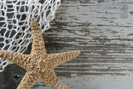 Sea Themed Background with Rustic Wood and  Fishing Net photo