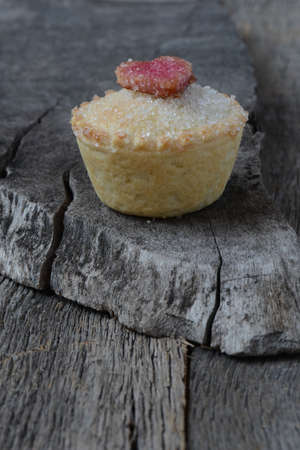 black berry: Black Berry Pie Cupcake with Heart and Sugar Topping on Wooden Background
