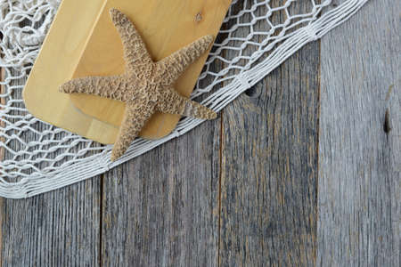 fish net: Sail Oars with Fish Net, rope and Starfish on Wood Backgrond