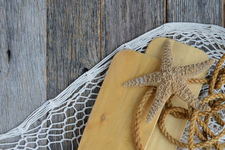 oars: Sail Oars with Fish Net, rope and Starfish on Wood Backgrond