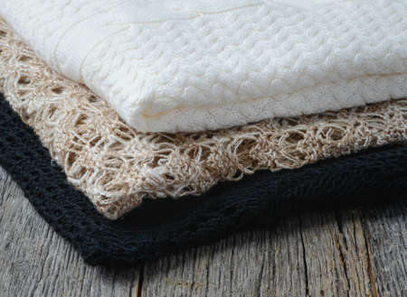 Close Up of Sweaters on Wooden Background photo