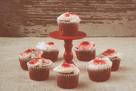 Cupcake on stand with rustic wood and Burlap backgound Stok Fotoğraf
