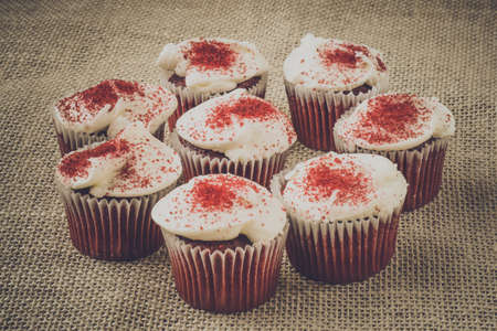 Cupcakes with rustic Burlap backgound