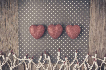 Hearts with red glitter on Polka Dot Background with Lights Banque d'images