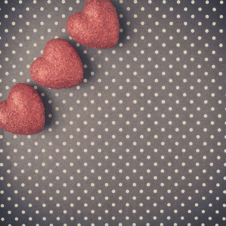 Hearts with red glitter on Polka Dot Background Banque d'images