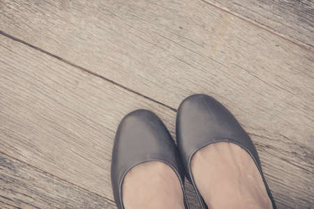 Feet. First-Person view  on rustic wood Floor background. Stok Fotoğraf