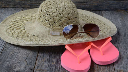 beach accessories on wooden board background
