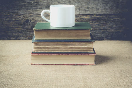 books  with coffe cup on retro background with Instagram Style Filter