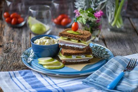 Ham Sliced Pear and Swiss Sandwich on Dark Rye