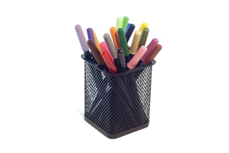 Small Felt tip Marker Pens  in a desk organizer for school, home, office, arts, crafts,   back to school projects with isolated background photo
