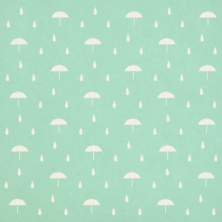seamless raindrops pattern with umbrella on paper texture photo