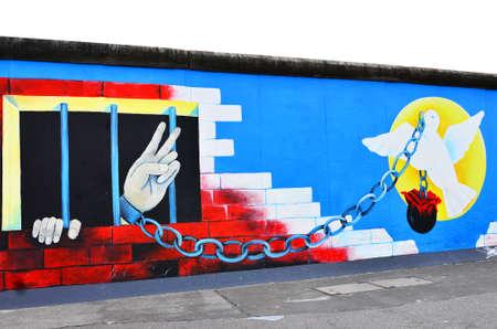 BERLIN - October 14   Graffiti on Berlin Wall at East Side Gallery October 14, 2011 in Berlin Stock Photo