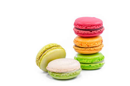 Tasty colorful macaroon on white background photo