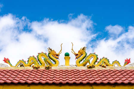 Dragon statue on the red roof Rak Thai Village ,Pai,Mae Hong  photo