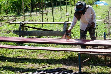 Workers painted steel pipe photo